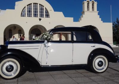 Old classic Mercedes for wedding rental ouside of a church